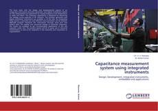 Buchcover von Capacitance measurement system using integrated instruments